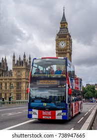LONDON UK - AUG 3: A sightseeing bus passes down Westminster Bridge with Big Ben in the background on August 3, 2017 in London, England. Westminster is a popular stop for the many tour buses.