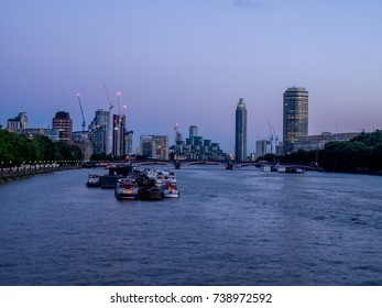 LONDON UK - AUG 3: View down the River Thames on July 31, 2017 in London England. The River Thames is a famous river that runs through the heart of London.