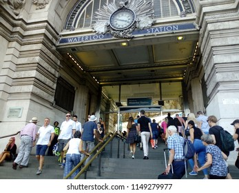 LONDON/ UK - AUG 4 2018: Passengers using London Waterloo station, which is the busiest railway station in the UK. It opened in 1838 and is a major transport hub in central London.