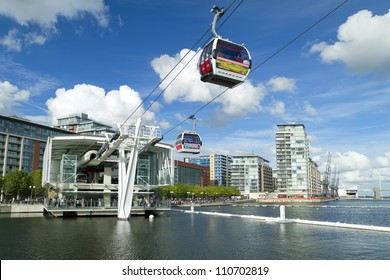 LONDON, UK - AUG 4: Visitors travel on the Emirates cable car. The service is London??s first urban cable car which crosses the Thames from Excel centre to the O2 on August 4, 2012 in London UK
