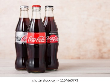 LONDON, UK - AUGUST 03, 2018: Glass bottles of Original Diet and Zero Coca Cola soft drink on wood. Most popular drink in the world.