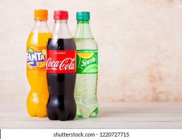 LONDON, UK - AUGUST 03, 2018: Plastic bottles of Coca Cola and Fanta and Sprite soft drink on wood. Most popular drinks in the world.