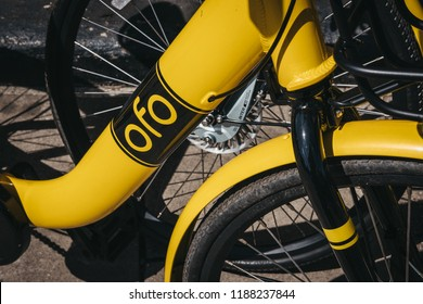 London, UK - August 1, 2018: Close up of a yellow Ofo bike on a street in London. Ofo is a dockless bike-sharing company that deployed over 10 million bicycles in 250 cities and 20 countries.