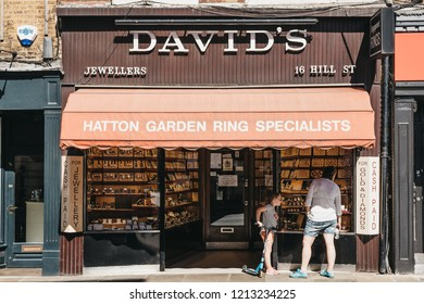 London, UK - August 1, 2018. Woman and her daughter looking at window display of David's Jewellers in Richmond, a suburban town in south-west London famous for large number of parks and open spaces