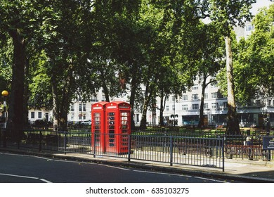 LONDON, UK - August 10, 2014: one of the characteristic red phone box in Central London in Mayfair