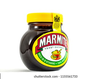 London, UK - August 10 2018: An unopened jar of Marmite over a plain white background with copy space and a clipping path cutout. Marmite is a yeast spread product