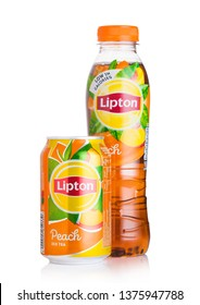 LONDON, UK - AUGUST 10, 2018: Aluminium can and plastic bottle of Lipton Ice Tea with peach flavour on white.