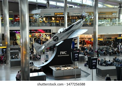 London, UK - August 10, 2019: Air travellers shop at duty free and wait for their flights at departures in Terminal 2 of Heathrow Airport. Heathrow is Europe's busiest airport by passenger traffic.