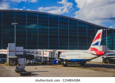 LONDON, UK - August 10th, 2018: view of Heathrow airport and British Airways airplane at their stands
