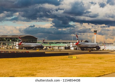 LONDON, UK - August 10th, 2018: view of Heathrow airport with stormy skies and British Airways airplanes at their stands