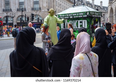 London, UK - August 11, 2015: Green Yoda street artist in London