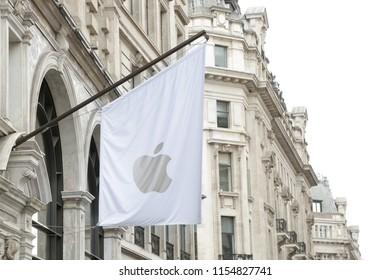 LONDON, UK - AUGUST 11, 2018: Apple flag flying outside new flagship store in Regents Street, London.