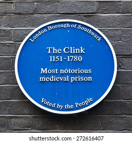 LONDON, UK - AUGUST 11: Blue Plaque commemorating the site of the notorious medieval prison The Clink, which functioned between the 12th and 18th centuries.  On Bankside, London, August 11 2012