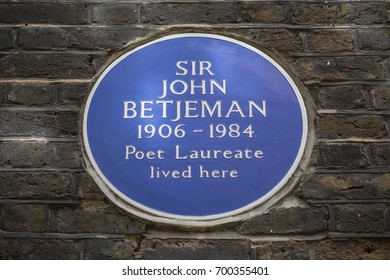 LONDON, UK - AUGUST 11TH 2017: A plaque marking the location where Sir John Betjeman once lived in Cloth Court, London, on 11th August 2017.
