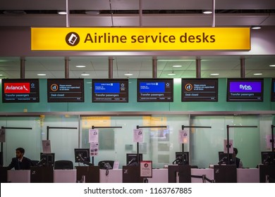 London, UK - August 12, 2018 - Airline services desks for transfer passengers at London Heathrow Airport
