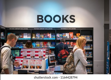 London, UK - August 12, 2018 - Travellers browsing in a bookshop at London Heathrow Airport terminal 5