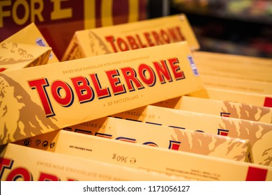 London, UK - August 12, 2018 - Toblerone Swiss milk chocolate on display at a duty free shop in London Heathrow Airport