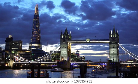 LONDON, UK - AUGUST 13, 2018: London Tower Bridge and the Shard at dusk