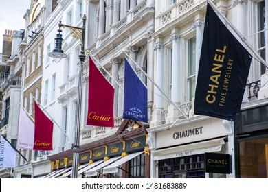 London, UK - August 13, 2019: Cartier and Chaumet jewel shop at Old Bond street. Bond Street is a major shopping street in the West End of London for luxury designer brands