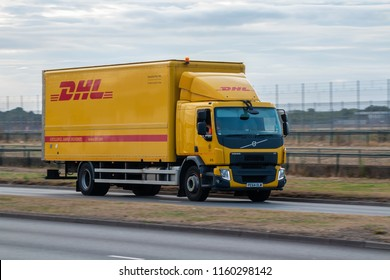LONDON, UK - AUGUST 17, 2018: Lorry belonging to logistic company DHL in motion on the road.
