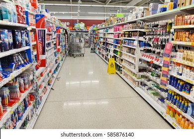 London, UK - August 18, 2014: An aisle is seen in an Asda supermarket. American company Walmart owns Asda, which is UK's largest retail chain after Tesco with 568 stores and income of £638mln in 2013.