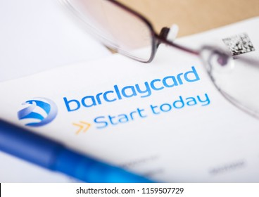 LONDON, UK - AUGUST 18, 2018: Barclays bank card statement  with reading glasses and blue pen.