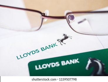 LONDON, UK - AUGUST 18, 2018: Lloyds Banking Group statement and credit card with glasses.