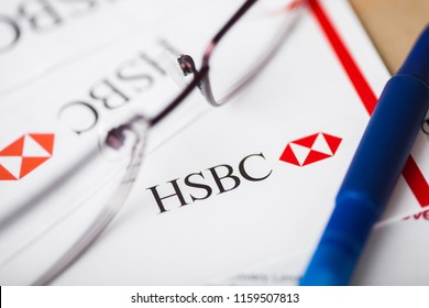 LONDON, UK - AUGUST 18, 2018: HSBC bank statement with logo and glasses.