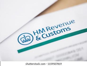 LONDON, UK - AUGUST 18, 2018: HM revenue & Customs statement with envelopes closeup