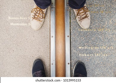 LONDON, UK - AUGUST 19, 2017 - Royal Observatory in Greenwich park, London, United Kingdom. The feet of tourists are on the prime meridian.