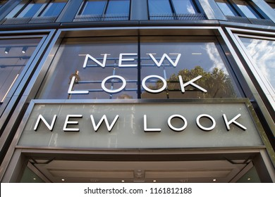 LONDON, UK - AUGUST 19, 2018: Close up of New Look clothes store logo at Oxford Street in central London. New Look is a British global fashion retailer