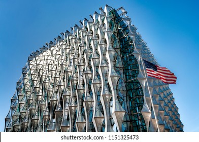 London, UK - August 1st 2018: The new Embassy of the United States of America and the USA flag in the foreground, located at 33 Nine Elms Lane, London, England