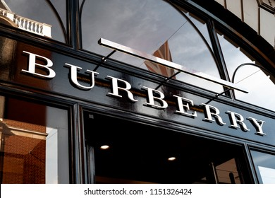 London, UK - August 1st 2018: Luxury fashion brand Burberry logo on a sign on storefront in the iconic Covent Garden in London, England