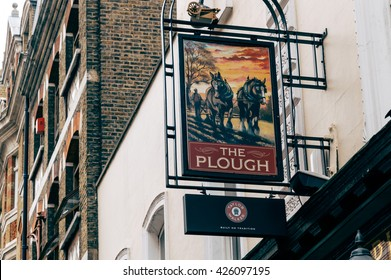 LONDON, UK - AUGUST 20, 2015:   Sign outside The Plough pub and restaurant in London.