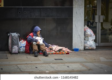 London, UK - August, 2018. A homeless man begging for help in central London.