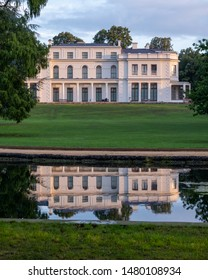 London UK, August 2019. Newly renovated mansion at Gunnersbury Park and Museum on the Gunnersbury Estate, once owned by the Rothschild family, reflected in a lake in the park.
