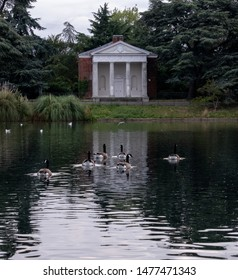 London UK, August 2019. Temple by the lake at newly renovated Gunnersbury Park and Museum on the Gunnersbury Estate. Ducks in the foreground.
