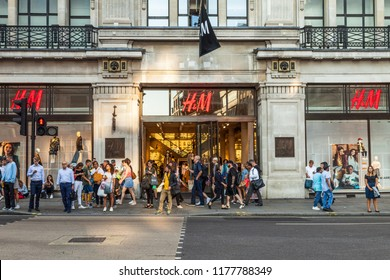 LONDON, UK - August 21st 2018:  H&M store front in Regents Street, Mayfair. H&M is a Swedish multinational clothing-retail company, known for its fast-fashion clothing for men, women and children.