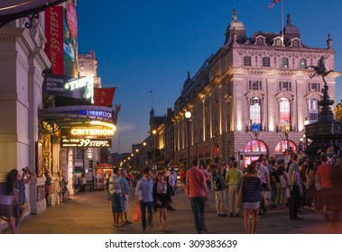 LONDON, UK - AUGUST 22, 2015: Piccadilly Circus in night. Famous place for romantic dates. Square was built in 1819 to join of Regent Street