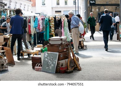 LONDON, UK - August 22, 2017: People shop at Old Spitalfields Market in London. A market existed here for at least 350 years