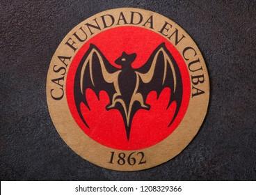LONDON, UK - AUGUST 22, 2018: Bacardi rum vintage paper mat coaster on black background.