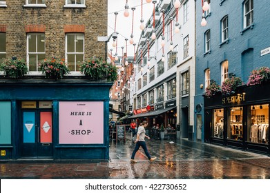 LONDON, UK - AUGUST 24, 2015: View of Carnaby Street. It is a pedestrianised shopping street in Soho in the City of Westminster