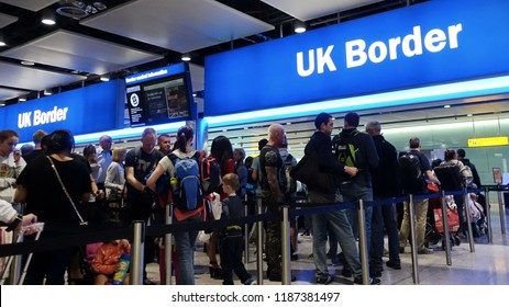 London, UK - August 24, 2018: Air travelers queue at border control at Heathrow Airport. EU passengers face uncertainty as the UK is due to leave the EU in 2019 with a no deal on brexit possible.