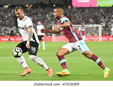 LONDON, UK - AUGUST 25, 2016: Denis Alibec (L) and Winston Reid (R) pictured during the UEFA Europa League last play-off game between West Ham United and Astra Giurgiu on London Stadium.