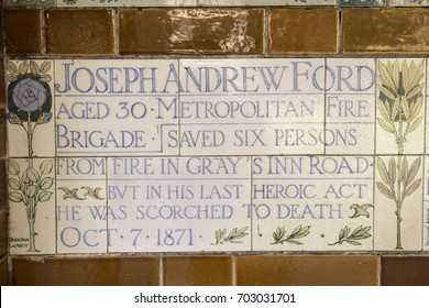 LONDON, UK - AUGUST 25TH 2017: Plaque at the Memorial to Heroic Self-Sacrifice in Postmans Park in London, on 25th August 2017. Dedicated to ordinary people who died while saving others.