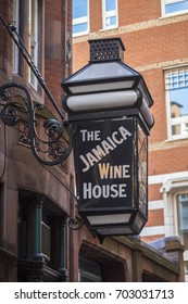 LONDON, UK - AUGUST 25TH 2017: Traditional sign of the Jamaica Wine House in St. Michaels Alley in the City of London, UK, on 25th August 2017.  It is known as the first coffee house in London.