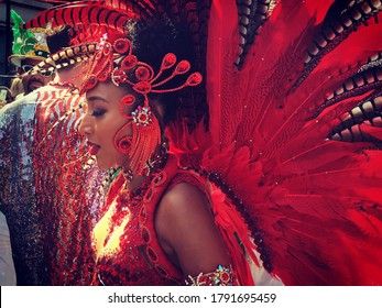 London / UK - August 27th 2019: Crowds of people enjoying the heatwave and dancing in the streets of London for the annual Notting Hill Carnival street festival of Caribbean culture, music and food