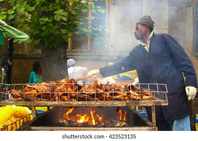 London, UK - August 29, 2010: A man prepares jerk chicken at the Notting Hill Carnival, one of the largest street festivals in Europe. The Caribbean-style Carnival is held every August in London.