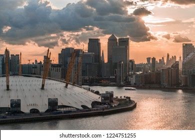 London, UK - August 31, 2017:  Aerial view of The O2 Arena and Canary Wharf Financial Centre during sunset.