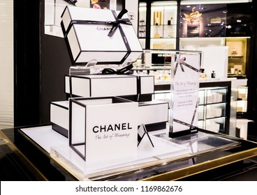 LONDON, UK - AUGUST 31, 2018: Chanel perfume and cosmetic makeup luxury collection in boutique store. Elegant shop.